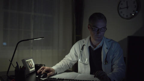 Doctor working at his office desk Footage