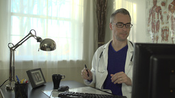 Doctor Working At His Office Desk stock footage