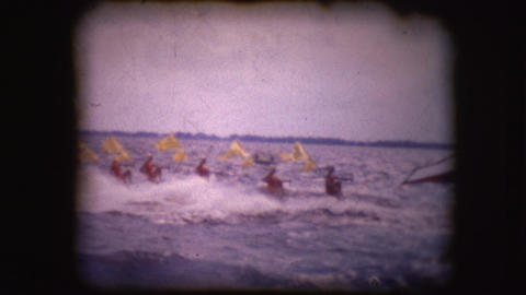 Vintage 8mm Footage Of Water Skiers Performing At Cypress Gardens stock footage