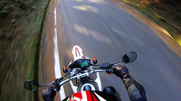 Helmet view. Rider is running on a narrow mountain road Footage