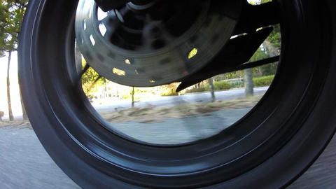 Rear wheel view. Rider was allowed to start the bike Footage