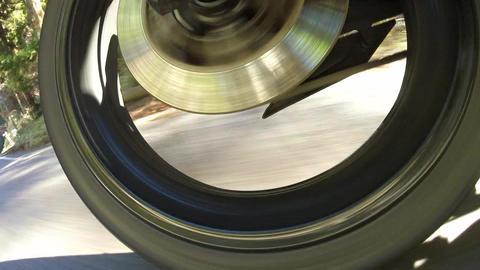 Rear wheel view. Bike go down the hill Footage