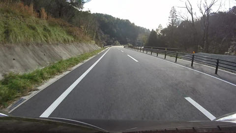 Bonnet view. The car running on a paved road Footage