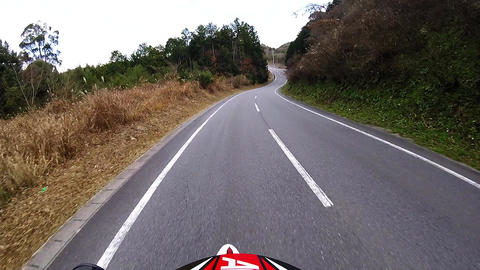 Helmet view. Rider is traveling the road to a height difference Footage