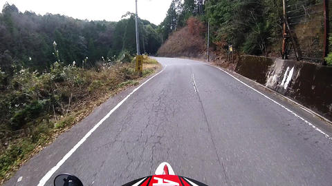 Helmet view. Rider is running on a mountain road at high speed Footage