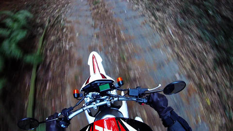 Helmet view. Rider is traveling over the stone pavement Footage