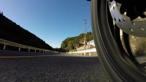 Rear wheel view. Rider is running on a country road Footage