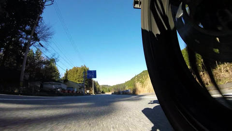 Rear wheel view. Rider is traveling the mountains Footage