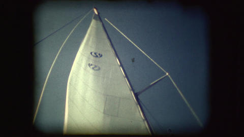 Vintage 8mm footage of people on Sail boats Live Action