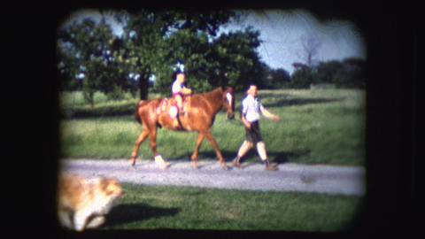 Vintage 8mm footage of people riding a horse Footage