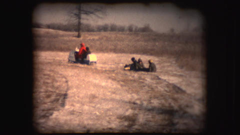 Vintage 8mm Footage Of Men And Boys Using A Snowmobile stock footage