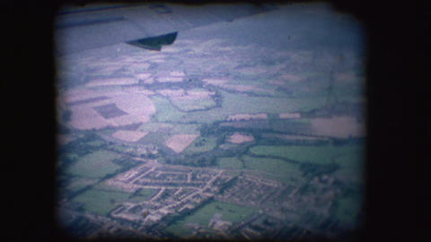 Vintage 8mm footage of from out of a plane window Footage