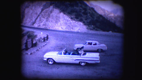 Vintage 8mm footage of a convertible car Footage