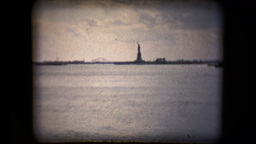 View of the Statue of Liberty from a boat in the mid 1960's Live Action