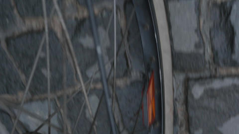 Detail of a bicycle wheel that goes on a road paved with cobblestone 72 Footage