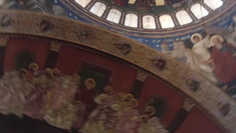 Religious painting on walls and dome of a big church 44p1 Footage