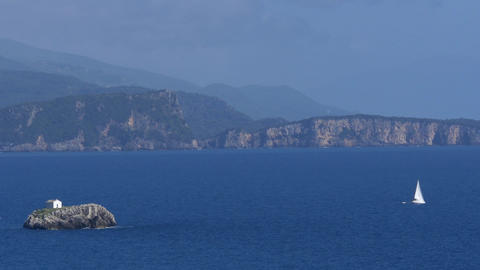 View of ocean coastline with steep slopes floating islands and boats 52 Footage