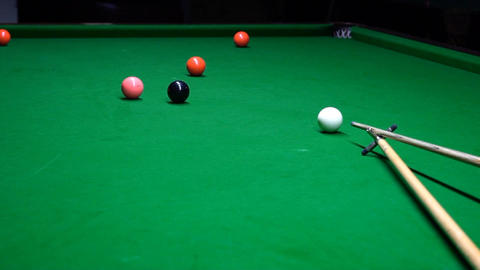 A Shot Behind The Snooker Balls And A Young Man Tries Slow Motion Footage