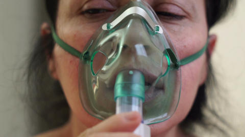 Woman Medical Nebulizer Breathing Mask Front Closeup Footage