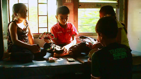 Indian Children Play Cards Laugh in Moving Train Carriage Footage