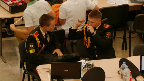 4K Ungraded: Two Military Academy Cadets Talk to Each Other During Robotics Footage
