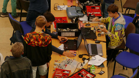 4K Ungraded: Young Participants and Organizers of Robotics Competition Actively Footage