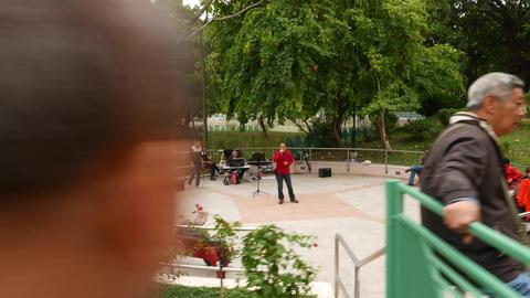 Karaoke singing area in Tuen Mun Park, panning shot Footage