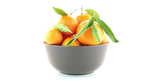 Tangerines on ceramic brown bowl Footage