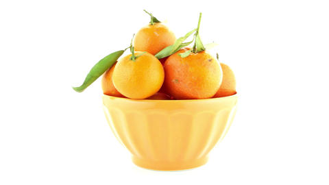 Tangerines on ceramic yellow bowl Footage