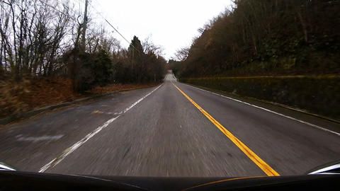 Bonnet view. The car running the hill at high speed Footage