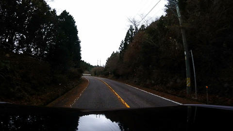 Roof View. Car is climbing a mountain road Footage