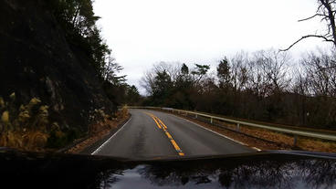 Roof View. The car running on the road along the cliff Footage