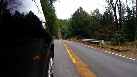 Side door view. The car running on a winding road Footage