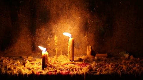 Beautiful dramatic burning candles and melting wax on altar Footage