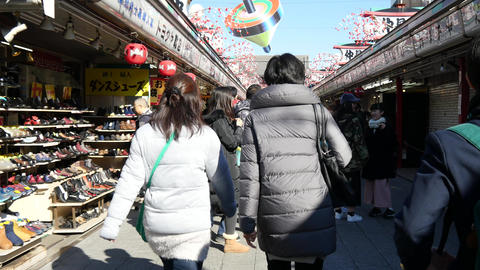 People walk on Senso-ji main street Footage