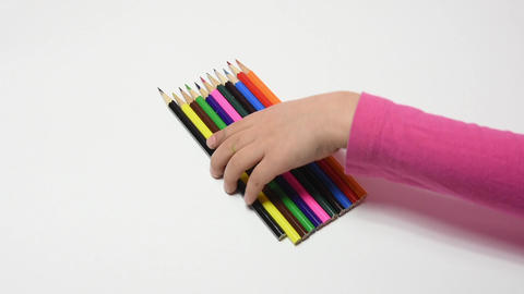 Children's hand has collected a set of colored pencils Footage
