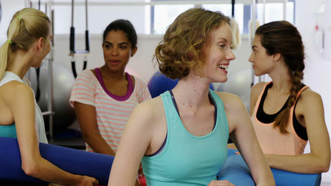 Beautiful woman interacting with each other in fitness studio Footage