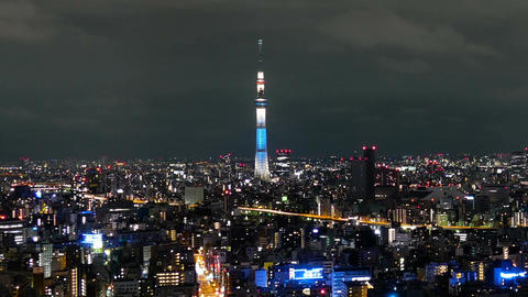 Elevated zoom out timelapse of city illumination in northeast Tokyo Archivo