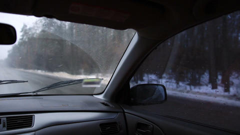 Driving car on highway in winter day Footage