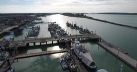Aerial view of fishing boat by the dock Footage