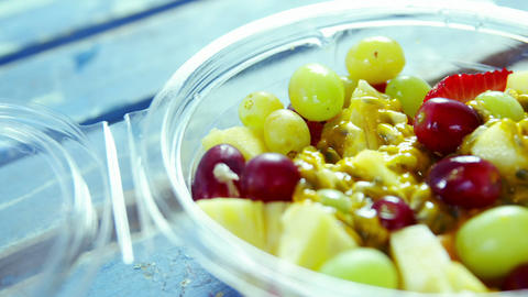 Fruit salad in plastic container Footage