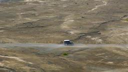 Off-road car drives through sand desert. Overland journey Footage