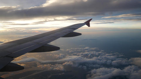 A view from the airplane. The aircraft is flying through the clouds Footage