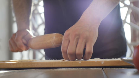 Closeup Cook Rolls Paste with Rolling Pin on Kitchen Table Footage