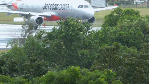Jetstar's Airbus A320-232 turns on runway from taxiway Footage