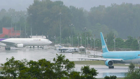 Ikar Airlines Boeing 767-300 painted blue taxis on runway before taking off Footage