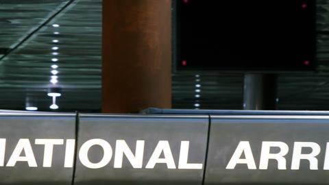 International arrivals sign Live Action