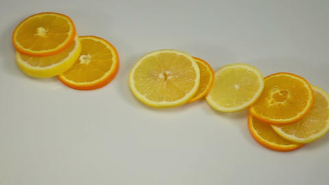 Citrus Fruit Slices Falling on the White Surface Footage