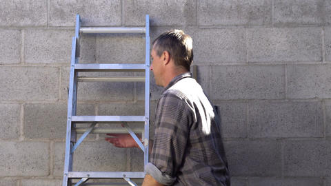 Man Takes Ladder Away Outdoors Footage