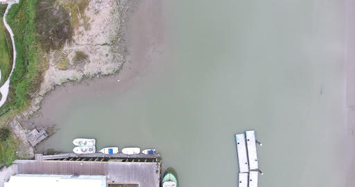 Aerial top down view of boats parked by the dock Footage